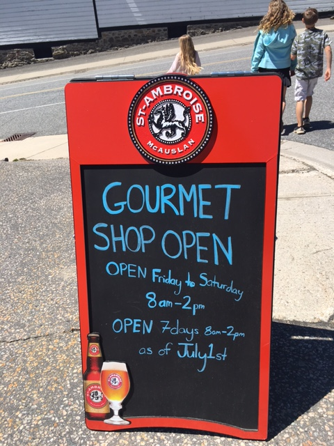 Crossroads gourmet shop sign